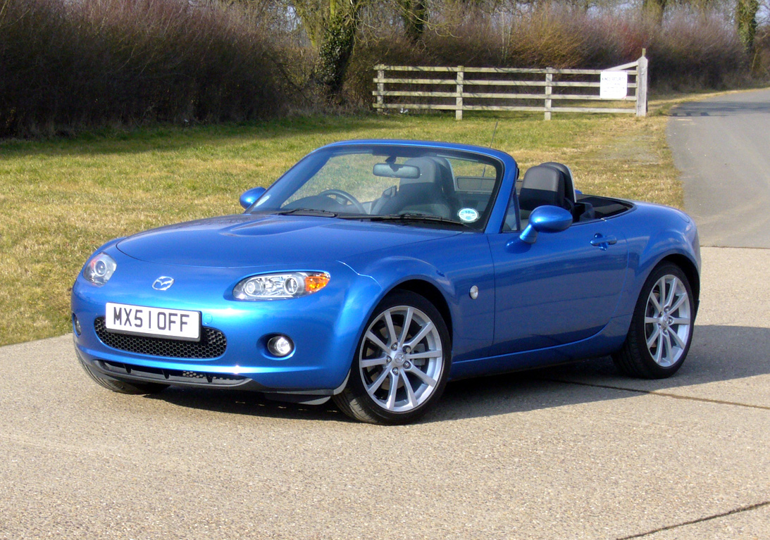 here's my sports car - it's a 2006 mazda mx5 miata, the color is