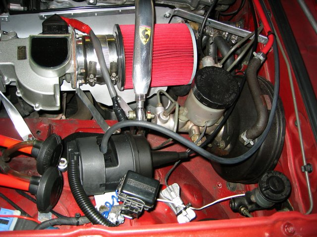 control module is incorporated into the servo), mounted on the driver's  side using the bolt that holds my custom diagnostic connector bracket
